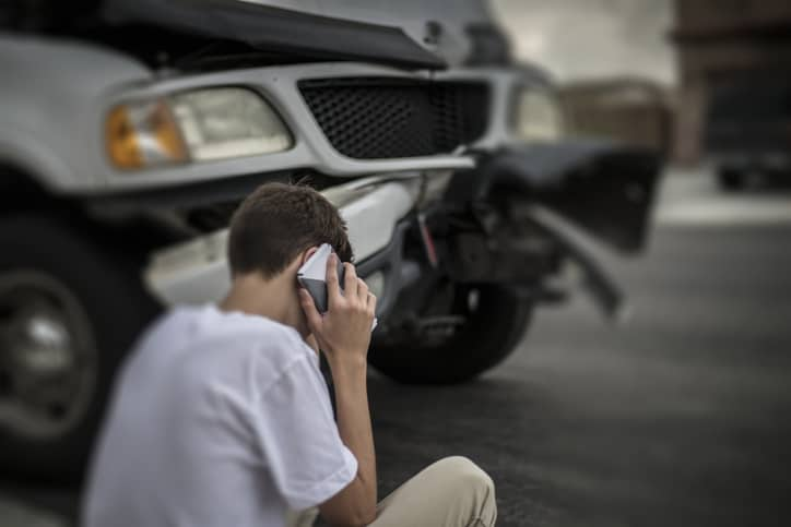 Man on phone at car accident